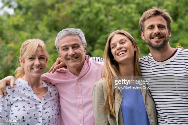 family enjoying in domestic garden - in law relations stock pictures, royalty-free photos & images