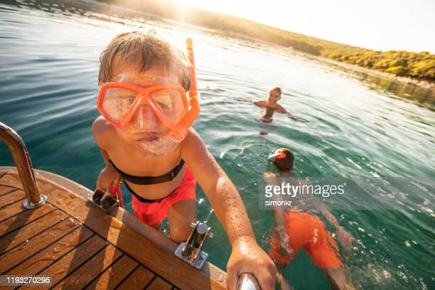 family enjoying in sea - sea swimming stock pictures, royalty-free photos & images