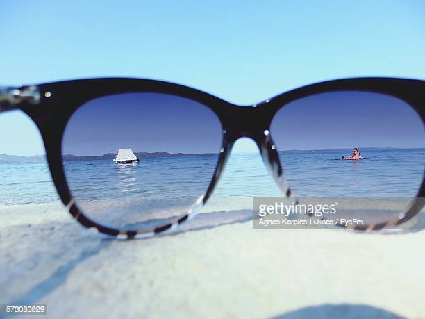Family Enjoying In Sea Seen Through Sunglasses