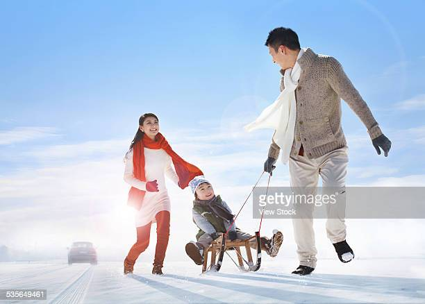 family enjoying in the snow - china east asia stock pictures, royalty-free photos & images