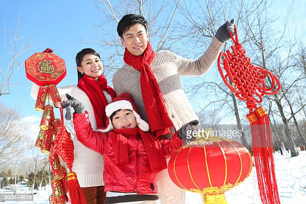 family enjoying in the snow - chinese knotting stock pictures, royalty-free photos & images
