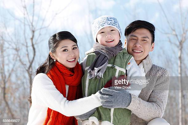 Family enjoying in the snow