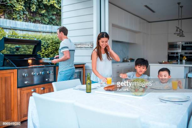 family enjoying lunch - geographical locations stock pictures, royalty-free photos & images