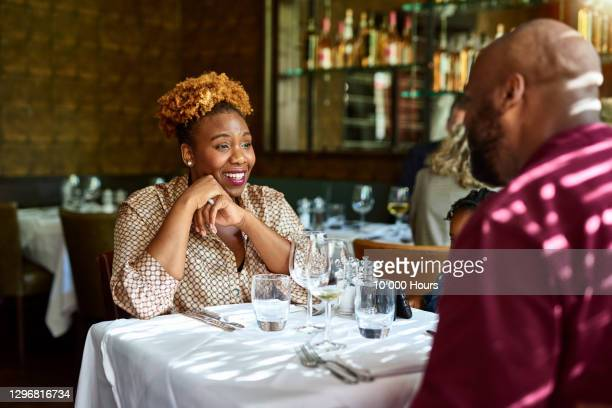 family enjoying meal in restaurant - couple relationship stock pictures, royalty-free photos & images