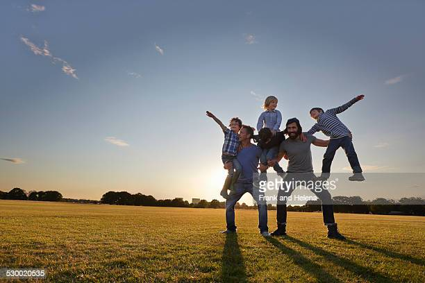 family enjoying outdoor activities in the park - pyramid stock pictures, royalty-free photos & images