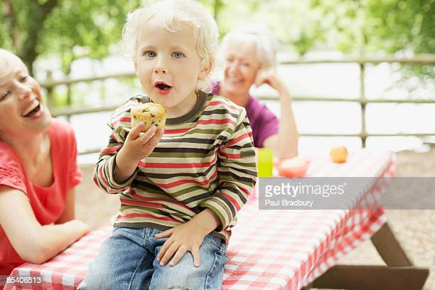 Family enjoying picnic in park