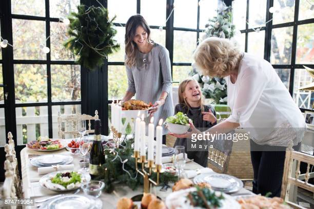 family enjoying preparing christmas - candle stock pictures, royalty-free photos & images