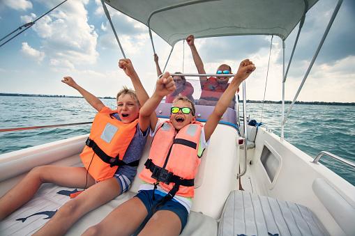 Family enjoying riding a boat on Lake Garda 1132788611
