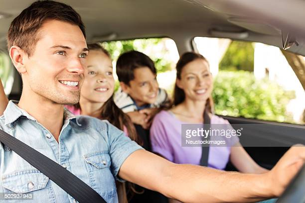 family enjoying road trip in car - family inside car stock photos and pictures