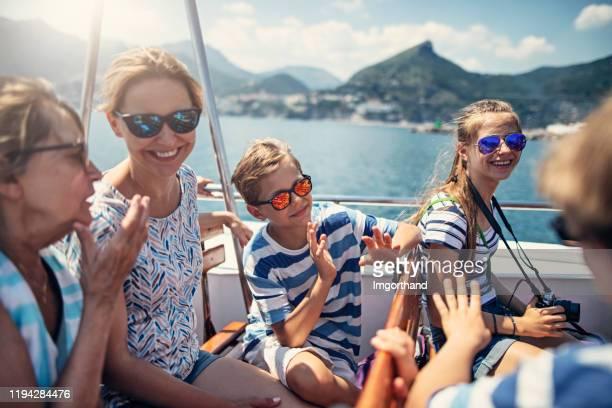 family enjoying sea ride at amalfi coast - cruise stock pictures, royalty-free photos & images