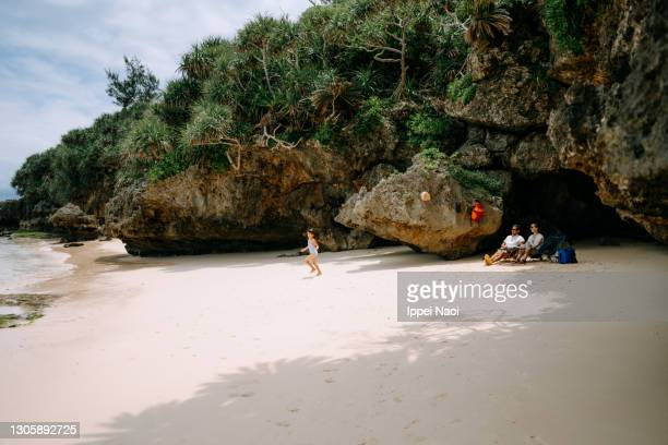 family enjoying secluded tropical beach, okinawa, japan - tropical climate stock pictures, royalty-free photos & images