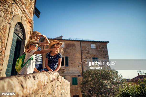 Family enjoying sightseeing small italian town