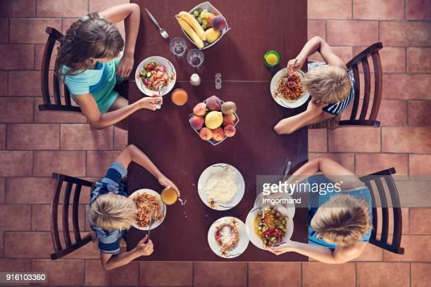 Family enjoying spaghetti lunch