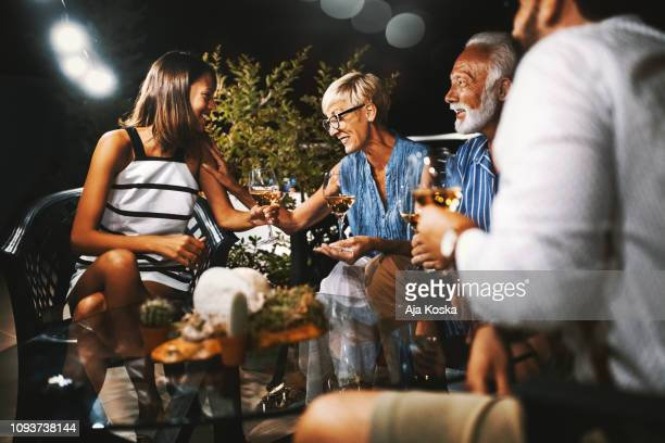 family enjoying summer night. - building terrace stock pictures, royalty-free photos & images
