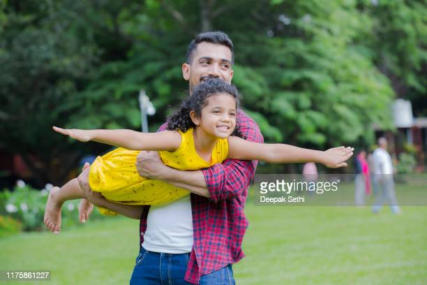 family enjoying summer picnic in the nature stock photo - india stock pictures, royalty-free photos & images