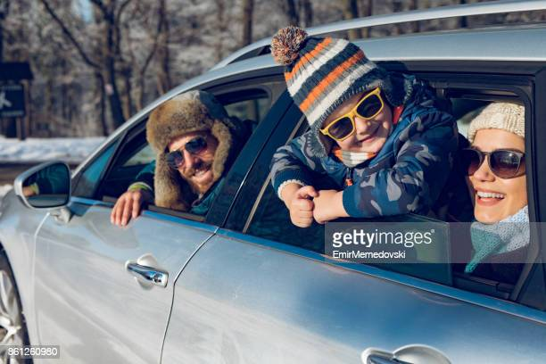 family enjoying the ride to mountain forest by car - winter family stock photos and pictures
