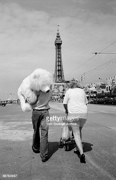 A family enjoying their holiday on Blackpool's Golden Mile Blackpool is the most popular coastal resort in the UK and has been attracting millions of...