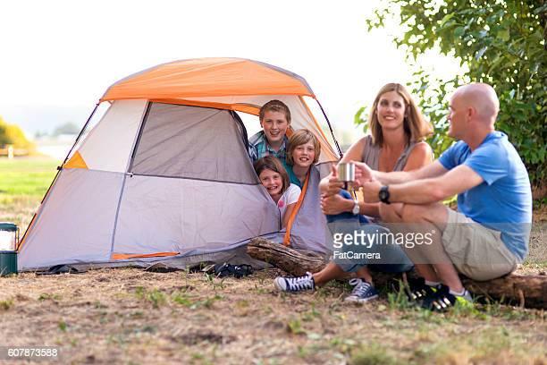 family enjoying their weekend camping trip