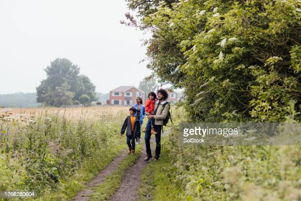 family enjoying time together - mixed race person stock pictures, royalty-free photos & images