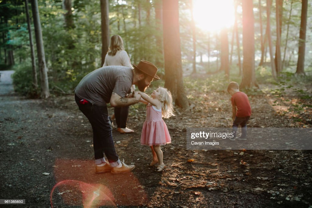 Family enjoying vacation in forest : Stock-Foto