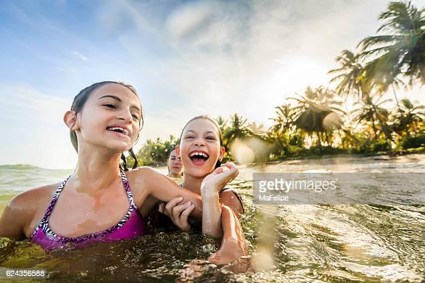 family enjoying vacations at sea - hot latina women stock photos and pictures