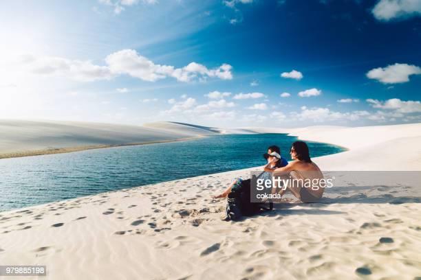 family enjoying vacations - lencois maranhenses national park stock pictures, royalty-free photos & images