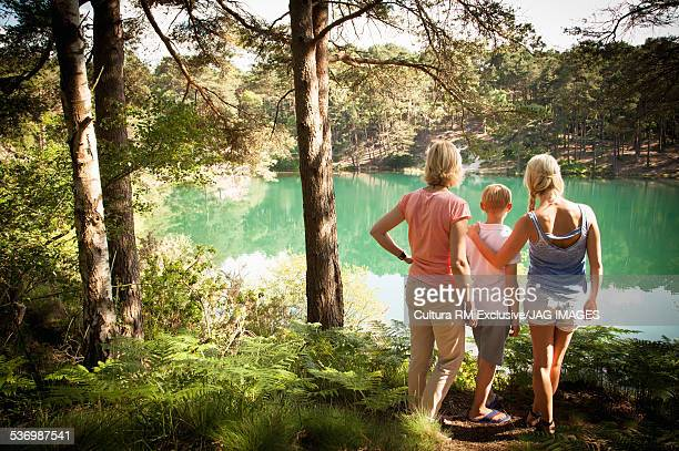 Family enjoying view by lake, The Blue Pool, Wareham, Dorset