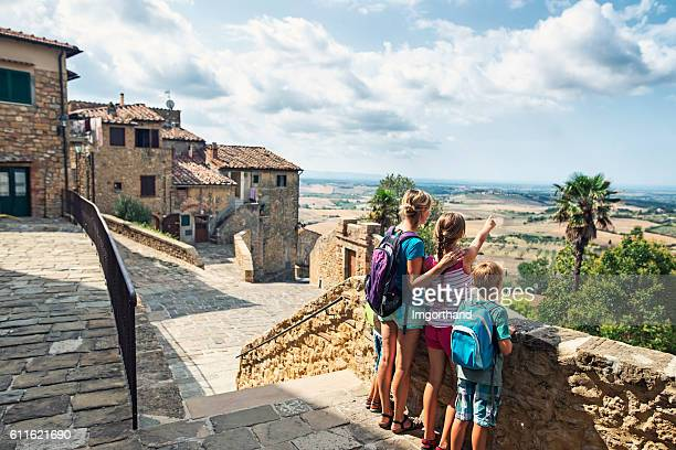 Family enjoying view in little Italian town in Tuscany