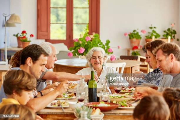 Family enjoying while having meal at table