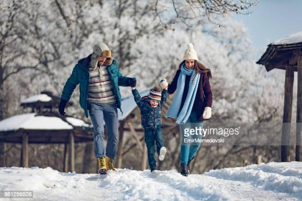 Family enjoying winter walk in the forest.