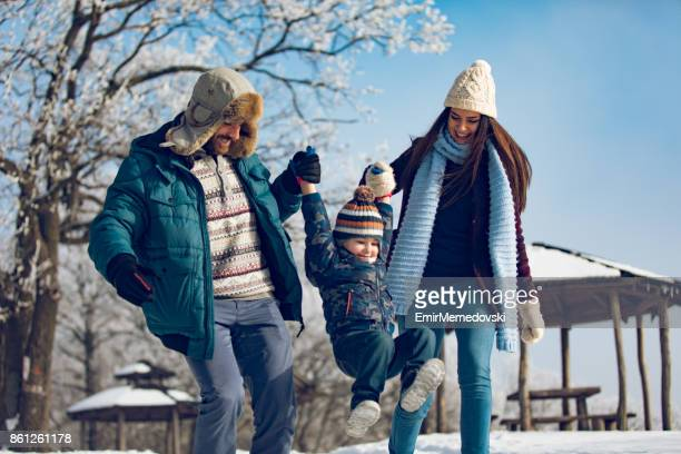 family enjoying winter walk in the forest. - winter coat stock pictures, royalty-free photos & images