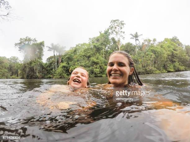 Family enjoys a guided exploration of the Amazon jungle on a remote part of the river.