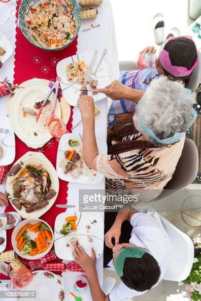 Family enjoys Christmas lunch - shot from above