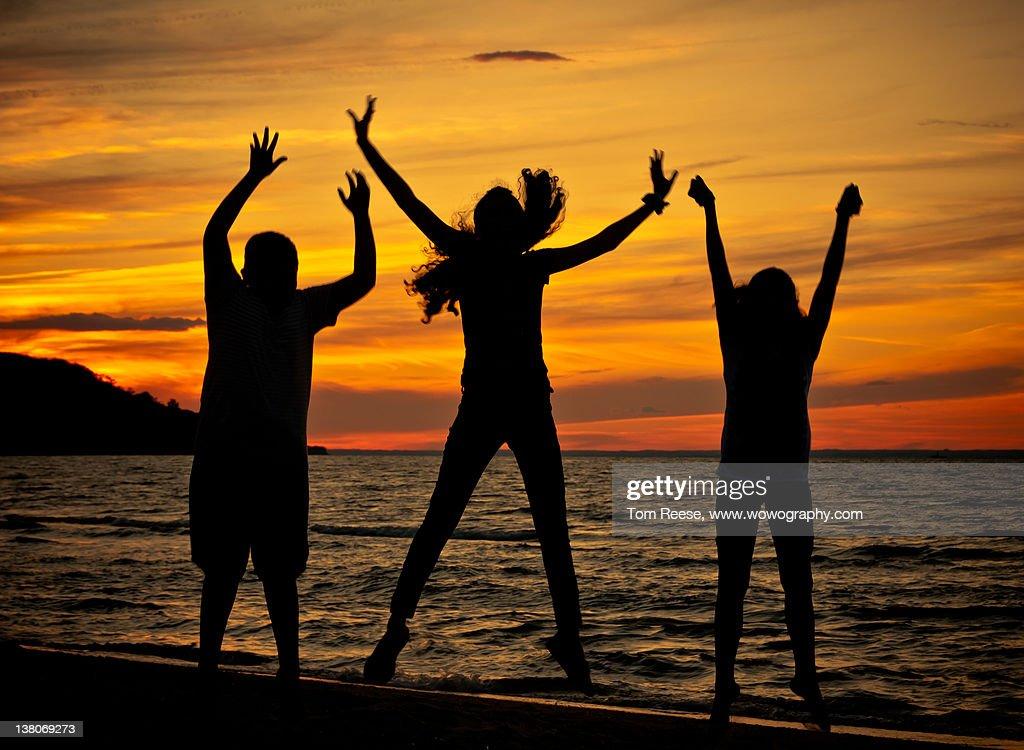 Family enjoys on beach in sunset : Stock Photo