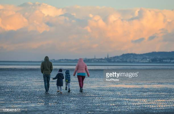Family enjoys Saturday afternoon walk on Sandymount Strand in Dublin during Level 5 Covid-19 lockdown. The Department of Health reported this evening...