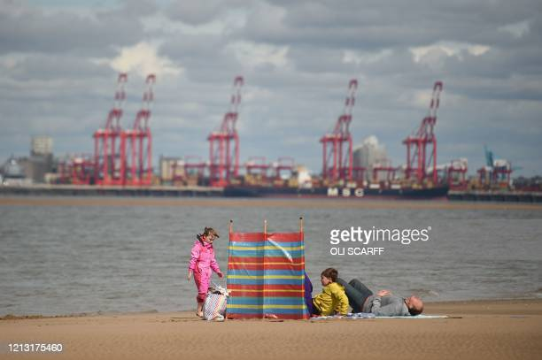 TOPSHOT A family enjoys the sunshine on New Brighton Beach Merseyside in north west England on May 16 following an easing of lockdown rules in...
