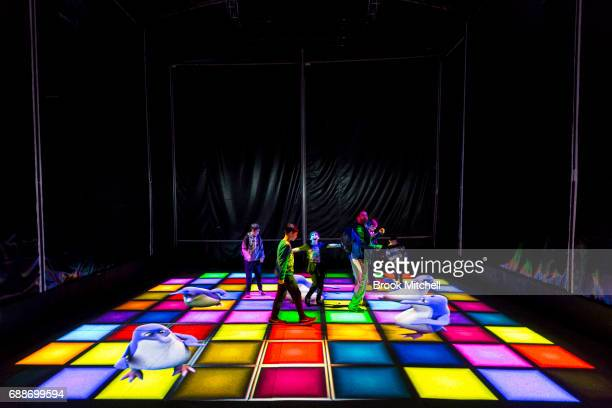 A family enjoys the Trapdoor light installation at Vivid on May 26 2017 in Sydney Australia Vivid Sydney is an annual festival that features light...