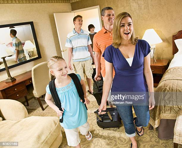 Family entering a hotel room