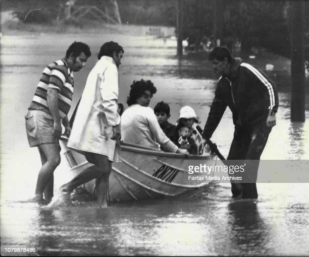 A family evacuated from a threatened home in hauled to safety in a boat in Oakes Road Old Toongabbie todayToongabbie Police hope to resume the search...