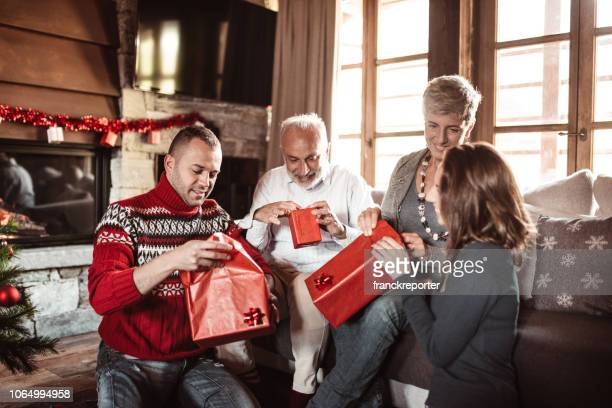 family exchanging gift at home for