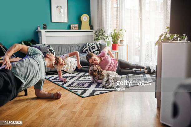 family exercise at home - home workout stock pictures, royalty-free photos & images