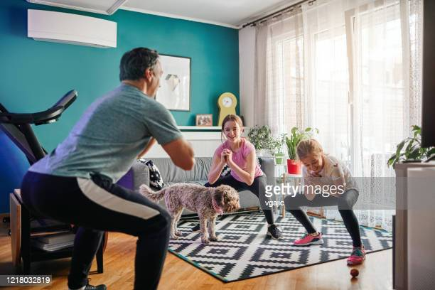 family exercise at home - squatting position stock pictures, royalty-free photos & images
