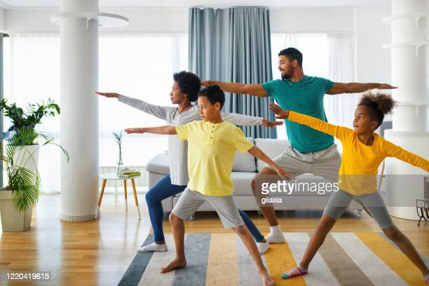 family exercising at home - relaxation exercise stock pictures, royalty-free photos & images