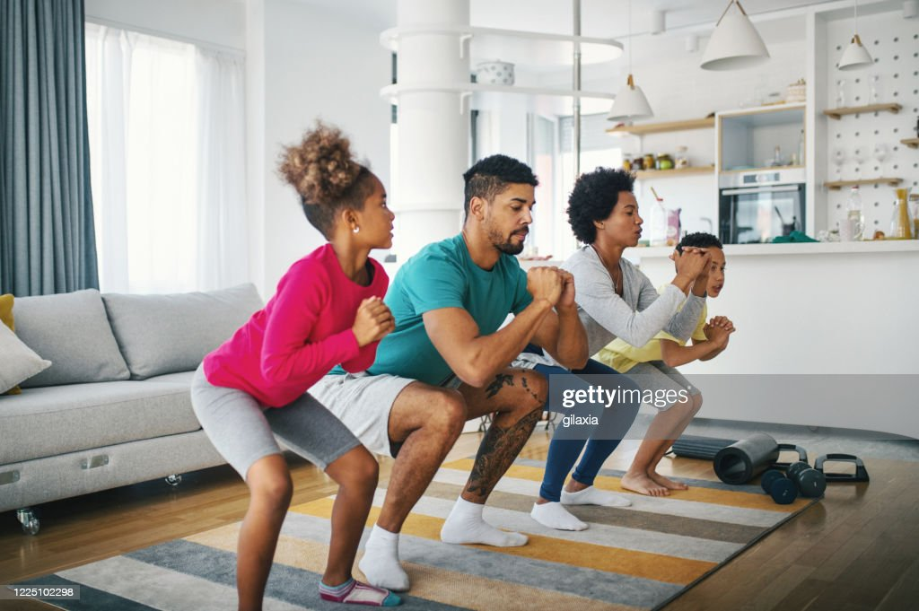 Family exercising at home : Stock Photo