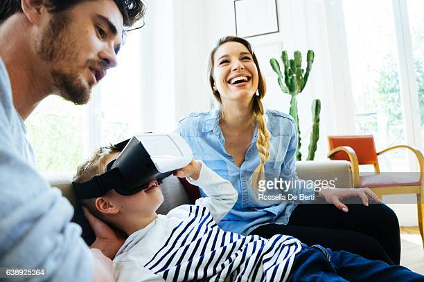 family experiencing virtual reality and having fan at home - 3d mom son stock photos and pictures