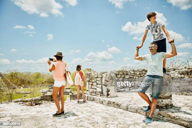 Family exploring Mayan ruins while on vacation