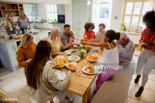 family feast! - roast dinner stock pictures, royalty-free photos & images