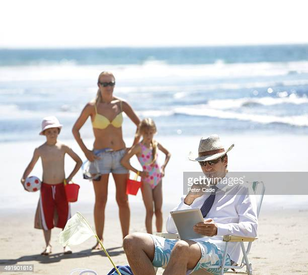 Family fed up with dad working on beach