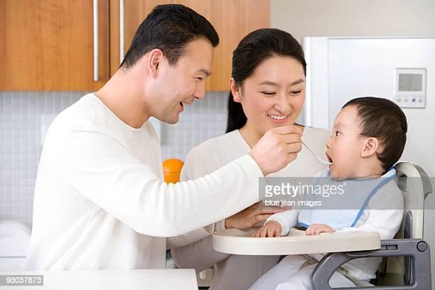 Family feeding child