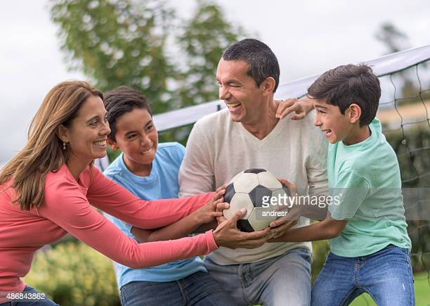 Family fighting for a soccer ball